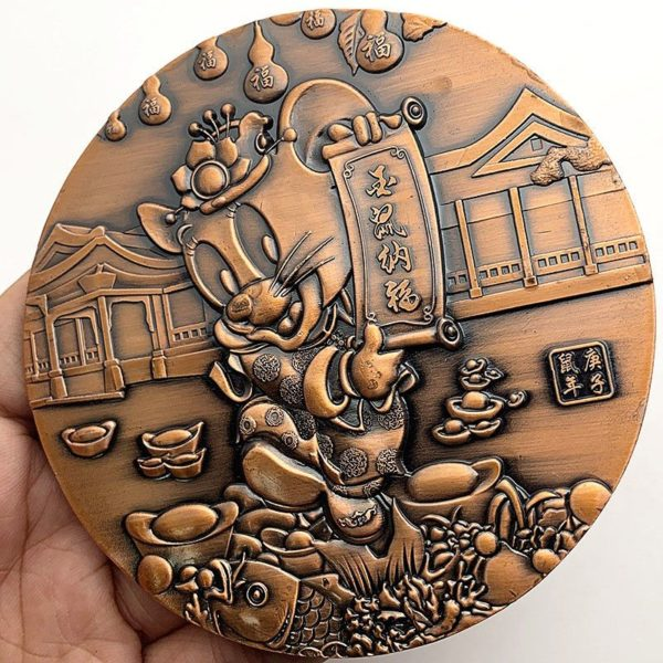 Mickey Mouse coins in relief